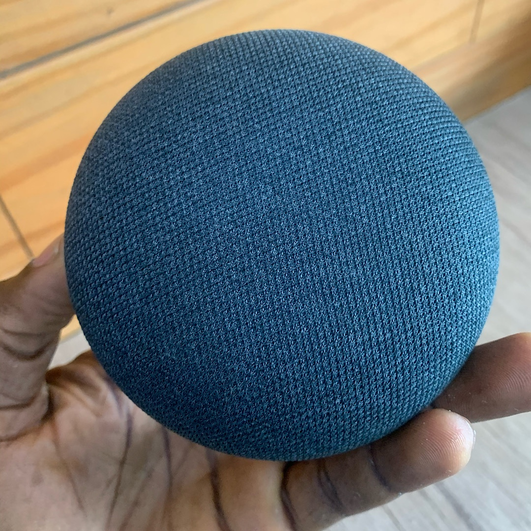 Google Home mini, power adapter and manual